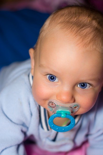 baby with chilled pacifier