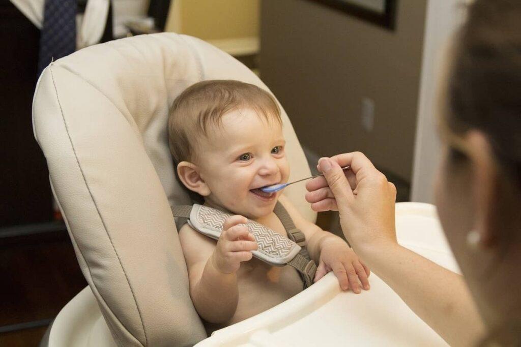 mommy feeding baby