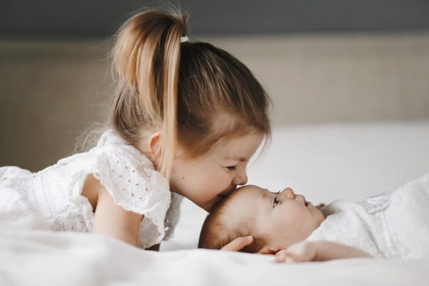 girl-kiss-baby-on-fore-head