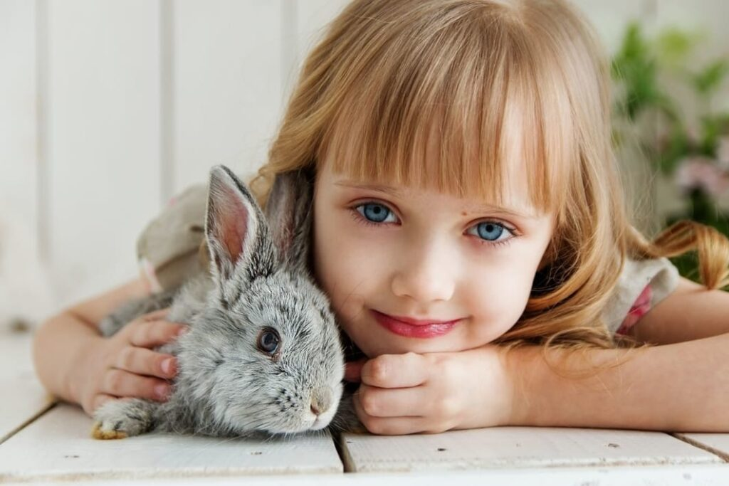 little girl holding her bunny